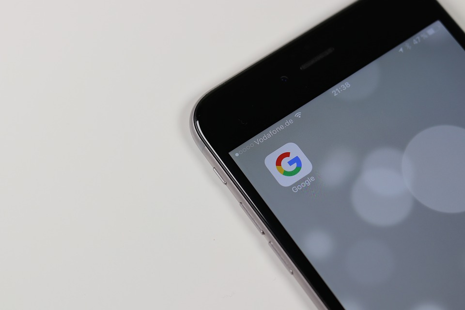Mobile device with a Google icon.